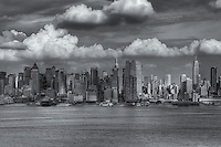 Storm clouds develop over the New York City mid-town Manhattan skyline during late afternoon prior to a summer thunderstorm.
