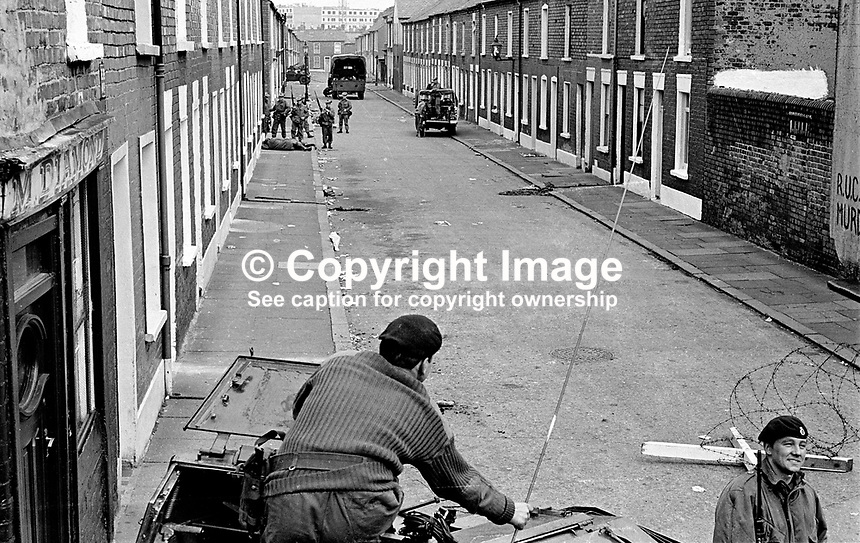 Soldiers patrol civilian-free street. 197007030251e...The British Army imposed during July 3 & 4, 1970, a 34 hour curfew (except for a two hour break to allow shopping) in approximately 50 streets in the Lower Falls district of Belfast, N Ireland, UK. A military helicopter hovered overhead warning people they would be arrested if they remained on the streets. An army search during the curfew uncovered 100 firearms, 100 home-made bombs, 250 lbs of explosives, 21000 rounds of ammunition and 8 two-way radios. This curfew is often seen as a turning point in souring relations between the Roman Catholic working class and the British Army. The army was no longer seen as the protector of the Catholic community...Copyright Image from Victor Patterson, 54 Dorchester Park, Belfast, UK, BT9 6RJ..Tel: +44 28 9066 1296.Mob: +44 7802 353836.Voicemail +44 20 8816 7153.Skype: victorpattersonbelfast.Email: victorpatterson@mac.com.Email: victorpatterson@ireland.com (back-up)..IMPORTANT: If you wish to use this image or any other of my images please go to www.victorpatterson.com and click on the Terms & Conditions. Then contact me by email or phone with the reference number(s) of the image(s) concerned.