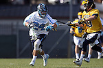 06 February 2016: North Carolina's Stephen Kelly (24) and Michigan's Chase Brown (49). The University of North Carolina Tar Heels hosted the University of Michigan Wolverines in a 2016 NCAA Division I Men's Lacrosse match. UNC won the game 20-10.