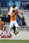 19 April 2014: Fort Lauderdale's Chris Nurse (GUY) (6) and Carolina's Enzo Martinez (URU) (15) challenge for a header. The Carolina RailHawks played the Fort Lauderdale Strikers at WakeMed Stadium in Cary, North Carolina in a 2014 North American Soccer League Spring Season match. Carolina won the game 4-1.