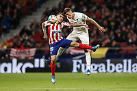8th February 2020; Wanda Metropolitano Stadium, Madrid, Spain; La Liga Football, Atletico de Madrid versus Granada; Angel Martin Correa (Atletico de Madrid)  wins the header from Jose Antonio Martínez (Granada CF)