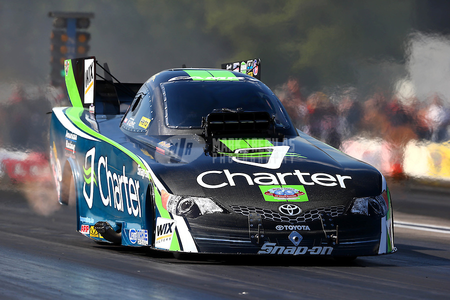 Aug. 17, 2013; Brainerd, MN, USA: NHRA funny car driver Tony Pedregon during qualifying for the Lucas Oil Nationals at Brainerd International Raceway. Mandatory Credit: Mark J. Rebilas-