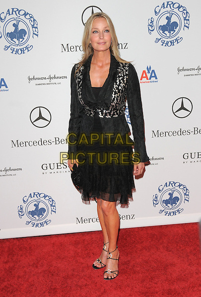 BO DEREK .attends The 30th Anniversary Carousel of Hope Ball Presented by Mercedes-Benz held at The Beverly Hilton Hotel in Beverly Hills, California, USA,.October 25th 2008..full length black dress jacket sandals shoes silver print .CAP/DVS.©Debbie VanStory/Capital Pictures