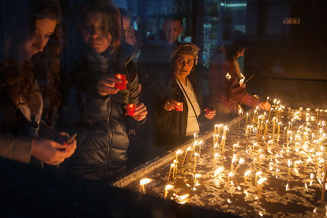 Romanian christian orthodox believers light candles at the St. Parascheva Metropolitan Cathedral in Iasi city. She is considered the Patron Saint and Protector of Moldavia and each year, on October the 14th, on the Saint's Day, hundreds of thousands of people from all over the county and abroad come on a pilgrimage. The pilgrimage take place every year in Iasi, a city 420 km northeast from Bucharest.