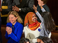 United States Representative Debbie Wasserman Schultz (Democrat of Florida), left, and US Representative Ilhan Omar (Democrat of Minnesota), right, enjoy a light moment, as does the child in Representative Omar's arms, as the 116th Congress convenes for its opening session in the US House Chamber of the US Capitol in Washington, DC on Thursday, January 3, 2019. Photo Credit: Ron Sachs/CNP/AdMedia
