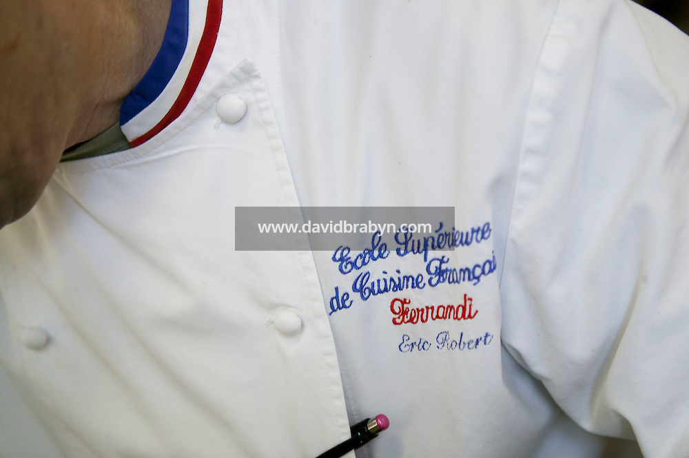 "View of embrodery on chef Eric Robert coat at the Ecole Superieure de Cuisine Francaise Gregoire Ferrandi cooking school in Paris, France, 19 December 2007. The red, whit and blue collar indicates that he has been recognized as a ""Meilleur Ouvrier de France""."