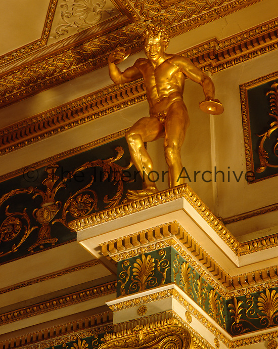 One of a series of gilded figures that grace the ancient verde-antique columns in the opulent Anteroom at Syon House