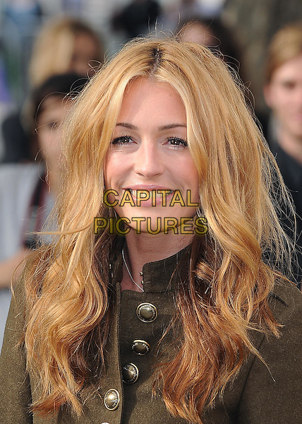 CAT DEELEY .attending the Burberry Prorsum Spring Summer Collection, during London Fashion Week at the Chelsea College of Art and Design, London, England, UK, September 21st 2010..LFW show portrait headshot green brass buttons .CAP/BEL.©Tom Belcher/Capital Pictures.