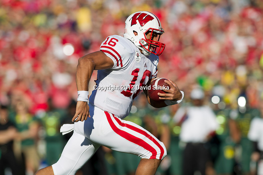 Wisconsin Badgers quarterback Russell Wilson (16) scores a rushing touchdown in the 1st quarter during the 2012 Rose Bowl NCAA football game against the Oregon Ducks in Pasadena, California on January 2, 2012. The Ducks won 45-38. (Photo by David Stluka)