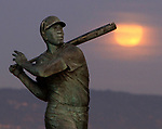 Novembers full moon rose over the Willie McCovey statue near Oracle Park, San Francisco, CA.