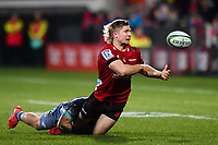 25th July 2020, Christchurch, New Zealand;  Jack Goodhue of the Crusaders passes in the tackle of Wes Goosen of the Hurricanes during the Super Rugby Aotearoa, Crusaders versus Hurricanes at Orangetheory stadium, Christchurch