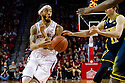 January 9, 2014: Terran Petteway (5) of the Nebraska Cornhuskers with a pass as he drives the lane against Nik Stauskas (11) of the Michigan Wolverines at the Pinnacle Bank Arena, Lincoln, NE. Michigan defeated Nebraska 71 to 70.