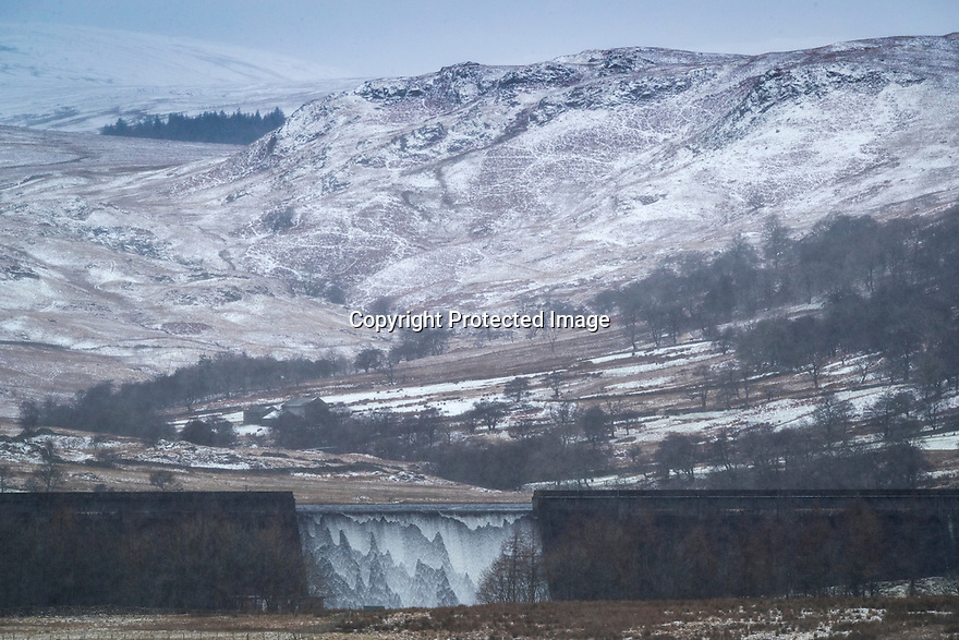 16/01/18<br /> <br /> Snow falls over the Lake District as water cascades over Wet Sleddale Reservoir near Shap in Cumbria.<br /> <br /> All Rights Reserved F Stop Press Ltd. +44 (0)1335 344240 +44 (0)7765 242650  www.fstoppress.com