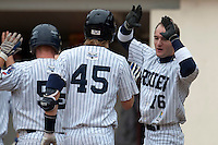 03 october 2009: Joris Bert of Rouen congratulates Luc Piquet as he scores during game 1 of the 2009 French Elite Finals won 6-5 by Rouen over Savigny in the 11th inning, at Stade Pierre Rolland stadium in Rouen, France.