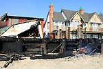 Flames still linger at the LG house where many celebrities came to party last summer, Malibu, California October 21, 2007. The wildfire fanned by powerful winds burned out of control on Sunday in the celebrity seaside enclave of  Malibu, forcing hundreds of people to flee and destroying a handful of multimillion-dollar homes. Photo by Nina Prommer/Milestone Photo.