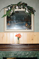 Fake flowers stand in a vase as Vermont senator and Democratic presidential candidate Bernie Sanders speaks at a campaign event at the White Mountain Chalet event hall in Berlin, New Hampshire.