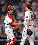 11 July 2008: Washington Nationals' catcher Wil Nieves shakes hands with relief pitcher Steven Shell after the winning out is recorded against the Houston Astros at Nationals Park in Washington, DC. The Nationals shut out the Astros 10-0 in the first game of their 3-game series...Mandatory Photo Credit: Ed Wolfstein Photo