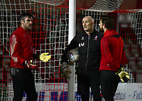 Lincoln City's Matt Gilks, left, Lincoln City's first team goalkeeping coach Andy Warrington, centre and Josh Vickers during the pre-match warm-up<br /> <br /> Photographer Andrew Vaughan/CameraSport<br /> <br /> The EFL Sky Bet League Two - Lincoln City v Yeovil Town - Friday 8th March 2019 - Sincil Bank - Lincoln<br /> <br /> World Copyright © 2019 CameraSport. All rights reserved. 43 Linden Ave. Countesthorpe. Leicester. England. LE8 5PG - Tel: +44 (0) 116 277 4147 - admin@camerasport.com - www.camerasport.com