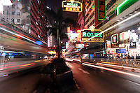 Tarffic speeds at night along Nathan road in Tsim Sha Tsui, Hong Kong. Nathan Road is the main thoroughfare in Kowloon, Hong Kong that goes in a south-north direction from Tsim Sha Tsui to Mong Kok.<br /> 30 Oct 2007