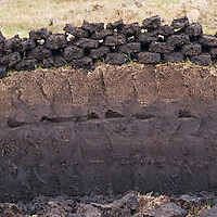 Traditional peat cutting in Scottish HIghlands.  The peat is dried and used for fuel