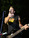 Kaohsiung, Taiwan -- Singer and bassist Ian Hardwick of GOOBER GUN on stage at the Brickyard Beer Garden on Aug. 17, 2013.