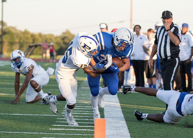 Leander Lions junior running back Adison LaRue (34) is pushed out of bounds by Pflugerville Panthers junior Jalyn Fuller (15) during a high school football game between Leander and Pflugerville at Bible Stadium in Leander, Texas on Thursday, September 7, 2017.