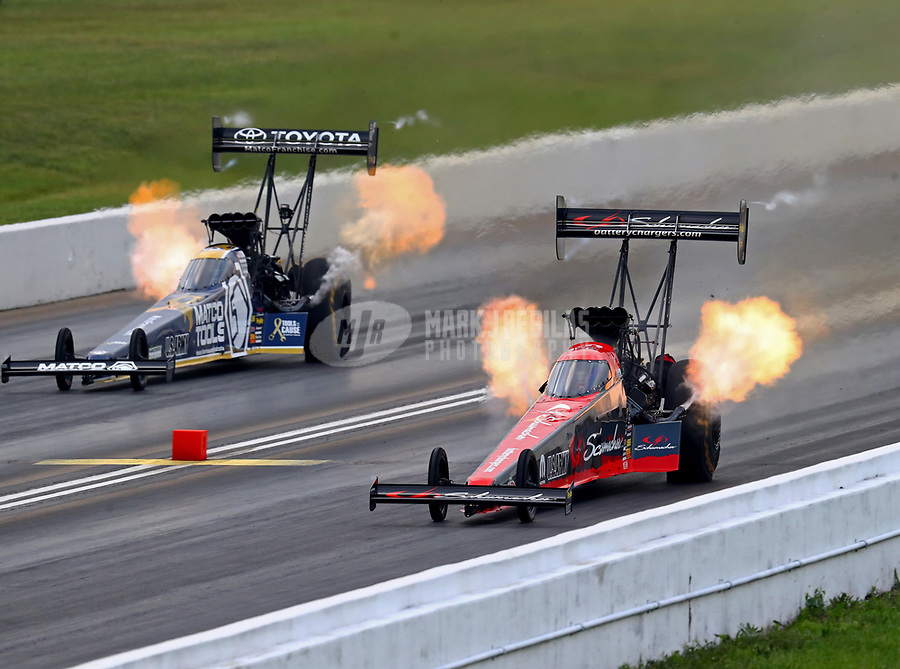 May 20, 2018; Topeka, KS, USA; NHRA top fuel driver Leah Pritchett (right) defeats teammate Antron Brown during the Heartland Nationals at Heartland Motorsports Park. Mandatory Credit: Mark J. Rebilas-USA TODAY Sports