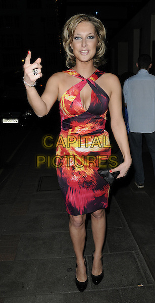GEMMA BISSIX .Attending the post-wedding party for Angellica Bell & Michael Underwood, The May Fair Hotel, London, England, UK, April 9th 2011..full length red cut out dress print  yellow black cleavage clutch bag shoes hand gesture  .CAP/CAN.©Can Nguyen/Capital Pictures.