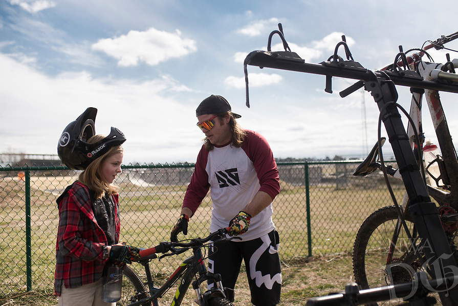 """Gage Schacherbauer, 9, (from left) and Andrew Schacherbauer, 30, of Pea Ridge pack their bikes for the Red Bull Pump Track World Championship qualifier, Sunday, January 26, 2020 at the Runway Bike Park in Springdale. Check out nwaonline.com/200127Daily/ for today's photo gallery.<br /> (NWA Democrat-Gazette/Charlie Kaijo)<br /> <br /> The Redbull Pump Track World Championship qualifier is on April 25th at the Runway Bike Park. """"We found Red Bull was hosting the championship and they're coming back. This is the only place in the US that hosts that,"""" said Andrew Schacherbauer who's practicing to qualify. """"There was someone who podiumed to qualify for this year's championship. It's inspiring to know someone local get in."""""""