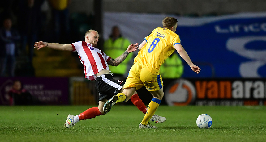 Lincoln City's Bradley Wood vies for possession with Chester's Tom Shaw<br /> <br /> Photographer Chris Vaughan/CameraSport<br /> <br /> Vanarama National League - Lincoln City v Chester - Tuesday 11th April 2017 - Sincil Bank - Lincoln<br /> <br /> World Copyright &copy; 2017 CameraSport. All rights reserved. 43 Linden Ave. Countesthorpe. Leicester. England. LE8 5PG - Tel: +44 (0) 116 277 4147 - admin@camerasport.com - www.camerasport.com