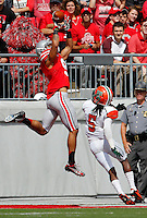 Ohio State Buckeyes wide receiver Devin Smith (9) catches a touchdown pass over Florida A&M Rattlers defensive back Patrick Aiken (5) during the first quarter of the NCAA football game at Ohio Stadium in Columbus on Sept. 21, 2013. (Adam Cairns / The Columbus Dispatch)