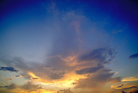 Cumulus and cirrus clouds reflecting sunset colors. Houston Texas.