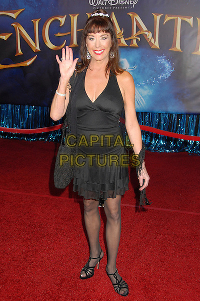 "PAIGE O'HARA.""Enchanted"" Los Angeles Premiere at the El Capitan Theatre, Hollywood, California, USA..November 17th, 2007.full length black dress hand palm waving .CAP/ADM/BP.©Byron Purvis/AdMedia/Capital Pictures."