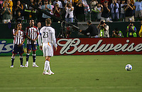 LA Galaxy midfielder David Beckham (23) prepares for a free kick over a Chivas wall of midfielder Francisco Mendoza (6) and forward Mykel Galindo (11). CD Chivas USA defeated the LA Galaxy 3-0 in the Super Classico MLS match at the Home Depot Center in Carson, California, Thursday, August 23, 2007.