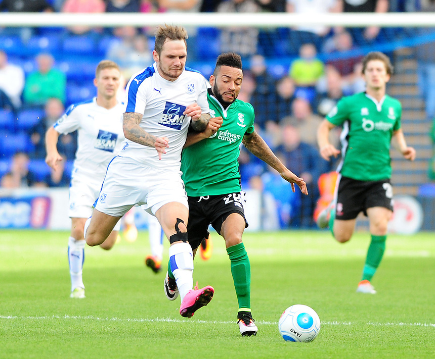 Lincoln City's Nathan Arnold vies for possession with Tranmere Rovers' James Norwood<br /> <br /> Photographer Andrew Vaughan/CameraSport<br /> <br /> Vanarama National League - Tranmere Rovers v Lincoln City - Saturday 10th September 2016 - Prenton Park - Birkenhead<br /> <br /> World Copyright &copy; 2016 CameraSport. All rights reserved. 43 Linden Ave. Countesthorpe. Leicester. England. LE8 5PG - Tel: +44 (0) 116 277 4147 - admin@camerasport.com - www.camerasport.com