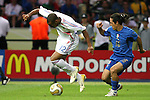 09 July 2006: Thierry Henry (FRA) (12) tries to control the ball under his feet as Mauro Camoranesi (ITA) (16) defends. Italy tied France 1-1 in overtime at the Olympiastadion in Berlin, Germany in match 64, the championship game, of the 2006 FIFA World Cup Finals. Italy won the World Cup by defeating France 5-3 on penalty kicks.