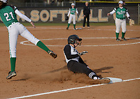 NWA Democrat-Gazette/BEN GOFF @NWABENGOFF<br /> Megan Crownover of Bentonville slides in safe at 3rd ahead of a throw to Van Buren's Caroline Davis Thursday, March 16, 2017, during the softball game at Bentonville's Tiger Athletic Complex.