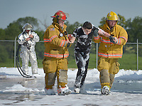 NWA Democrat-Gazette/BEN GOFF &bull; @NWABENGOFF<br /> Firefighters from multiple agencies help simulated victims on Saturday Aug. 8, 2015 during a full-scale training exercise at Northwest Arkansas Regional Airport in Highfill. The exercise for agencies in Benton County that respond to emergencies at the airport simulated a plane crash scenario.