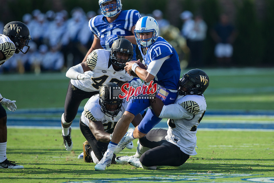 Daniel Jones (17) of the Duke Blue Devils is sacked by Duke Ejiofor (53) of the Wake Forest Demon Deacons during second half action at Wallace Wade Stadium on September 10, 2016 in Raleigh, North Carolina.  The Demon Deacons defeated the Blue Devils 24-14.  (Brian Westerholt/Sports On Film)