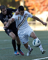 Boston College midfielder/defender Colin Murphy (21) attempts to control the ball as Brown University midfielder Michel Comitis (14) defends. Brown University (black) defeated Boston College (white), 1-0, at Newton Campus Field, October 16, 2012.