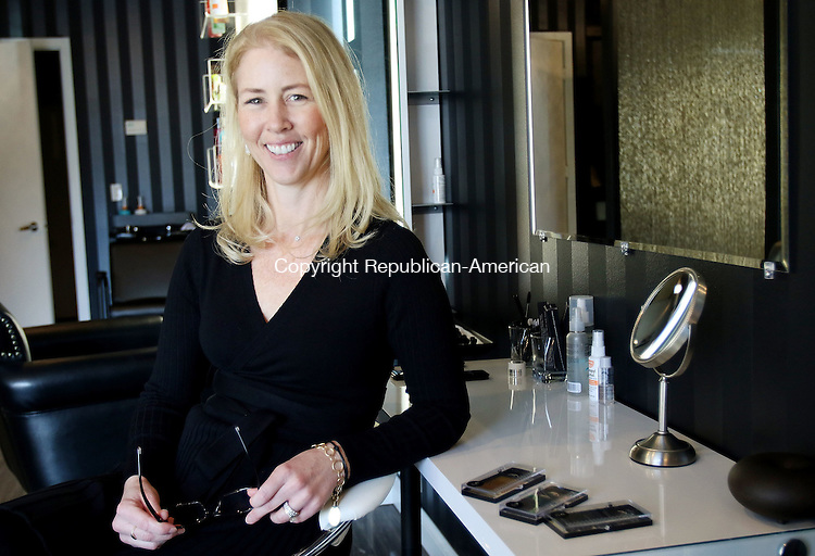 MIDDLEBURY CT. 27 January 2016-012716SV04-Debbie Verzino of Iconic Studio stands in her studio in Middlebury Wednesday. Their mission is to give women that feeling of always looking their best, while making it easier than it has been in years.<br /> Steven Valenti Republican-American