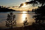 Idaho, Hayden Lake. An thin layer of ice shines in the winter sun over Preston Beach on Hayden Lake.