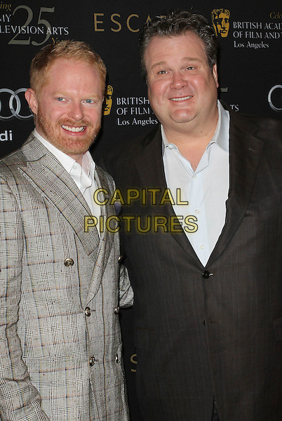 Jesse Tyler Ferguson & Eric Stonestreet.18th Annual BAFTA Los Angeles Awards Season Tea Party held at the Four Seasons Hotel, Beverly Hills, California, USA..January 14th, 2012.half length grey gray suit black shirt beard facial hair brown jacket  .CAP/ADM/KB.©Kevan Brooks/AdMedia/Capital Pictures.