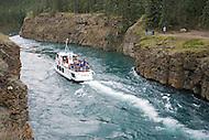 M.V. Schwatka cruises the Yukon River through Miles Canyon at the suspension bridge