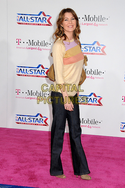 ELLEN POMPEO.T-Mobile Magenta Carpet at the 2011 NBA All-Star Game held at LA Live, Los Angeles, California, USA..February 20th, 2011.full length jeans denim beige purple pink jumper sweater top bag purse side .CAP/ADM/BP.©Byron Purvis/AdMedia/Capital Pictures.