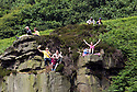 Grand Depart - Tour de France 2014<br /> Yorkshire England.<br /> Second stage passes through &quot;Blubberhouses Moor&quot;<br /> on the road from Harrogate<br /> Cycling fans high on the rocks for a view<br /> <br /> <br /> Pic by Gavin Rodgers/Pixel 8000 Ltd