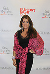Lisa Vanderpump wearing Valentino poses with Giggy - Celebrity Fashion Stylist Felix Mercado's Fashion Nght Out Runway Show and After Party was held on September 6, 2012 at Loehmann's, New York City, New York  Lisa Vanderpump (The Real Housewives of Beverly Hills) (Photo by Sue Coflin/Max Photos)