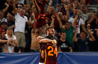 Calcio, Champions League, Gruppo E: Roma vs Barcellona. Roma, stadio Olimpico, 16 settembre 2015.<br /> Roma&rsquo;s Alessandro Florenzi, right, is hugged by teammate Daniele De Rossi after scoring during a Champions League, Group E football match between Roma and FC Barcelona, at Rome's Olympic stadium, 16 September 2015.<br /> UPDATE IMAGES PRESS/Riccardo De Luca