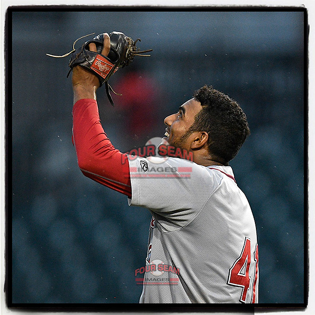 Pitcher Denyi Reyes (41) of the Greenville Drive points to the sky after posting a nine-inning complete-game shutout against the Columbia Fireflies on Sunday, May 27, 2018, in Columbia, S.C. Greenville won, 3-0. It was the first in the SAL this season. (Tom Priddy/Four Seam Images)