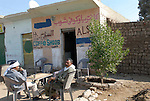 Two men sitting at a cafe in a village on the West Bank near Luxor.The town of Luxor occupies the eastern part of a great city of antiquity which the ancient Egytians called Waset and the Greeks named Thebes.